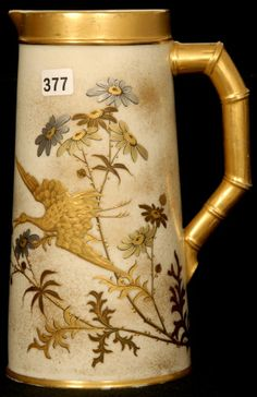 """9"""" ROYAL WORCESTER COLUMNAR SHAPE PITCHER, CIRCA 1883, CREAM TONES WITH BIRD, BUTTERFLY AND FLORAL DECOR, GOLD BAMBOO HANDLE, GOLD TRIM"""