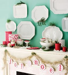 Decorate your mantle with ornaments, dishware and garland. More #holiday decorating projects: http://www.bhg.com/christmas/crafts/paper-fabric-christmas-crafts-decorations/#page=13