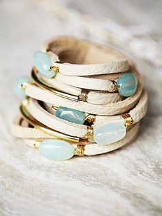 Baton Leather Wrap Cuff | Handmade in Aspen, CO from the finest soft and supple leathers, this beautiful statement wrap bracelet features precious metal accents throughout and stone detailing. This is an investment piece you will wear over and over again. Snap closure.