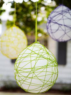 Make egg chandeliers with balloons and yarn. - put dragons in them and hang over dessert or food table.