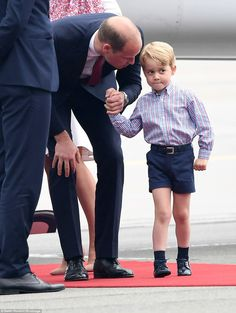 Prince William was seen leaning down to say a few words to his son, who looked a little overwhelmed by the occasion