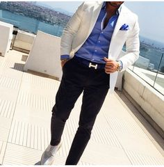 white jacket lighter blue shirt and darker blue (almost black) pants, the handkerchief is same as the shirt look at them shoes so class and chic style for men