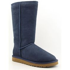 Enjoy the signature look of the UGG Classic Tall Bomber boots. Features a twin-face sheepskin upper with a suede heel guard and an adjustable cuff. Sheepskin lining offers plush comfort. A padded foam