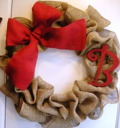 Burlap Wreath ~ love the big red bow! And then maybe a merry christmas for the holidays