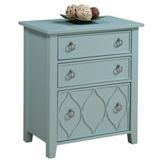 Display vibrant blooms or neutral decor on this slate blue-finished chest, showcasing ring pulls and textural ogee details for eye-catching appeal.