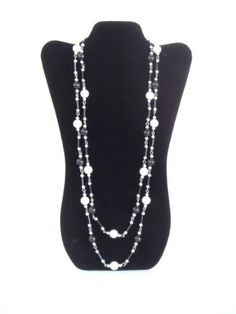 "NEW Black Velvet Necklace Jewelry Display Easel 14"" H by Select Jewelry Display. $5.82. Sturdy Easel Support. Puffed Pad Feature. Black Velvet Finish. Necklace Display is padded and finished off with Black Velvet. Measurements are 8- 5/8"" W x 14 - 1/8"" H.. Save 42% Off!"