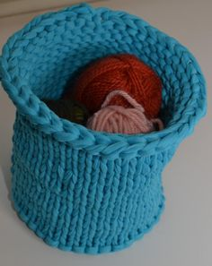 This easy bowl or basket is relatively quick to knit with a yarn made from remnants of garment manufacturing. Use it to hold yarn or anything else that needs containing.