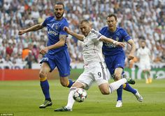 Benzema has an early shot at goal under pressure from Juventus duo Leonado Bonucci (left) and Stephan Lichtsteiner