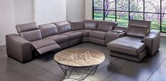 Large 100% leather electric modular. Features electric powered Recliner and Recliner Chaise, a storage Console with drink holders and adjustable headrests. Pieces can be added or subtracted to suit your space.