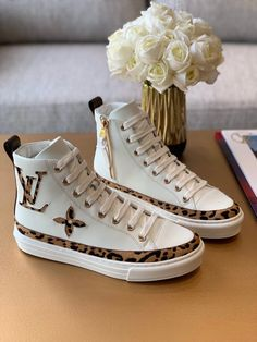 Louis Vuitton Monogram Jungle Stellar Sneaker Boot part of the LV Jungle capsule collection of accessories and leather goods, the Stellar sneaker boot comes in soft white calfskin decorated with giant LV and Monogram-Flower patches in leopa Tenis Louis Vuitton, Louis Vuitton Sneakers Women, Zapatillas Louis Vuitton, Louis Vuitton High Tops, White Louis Vuitton, Louis Vuitton Boots, Louis Vuitton Monogram, Luis Vuitton Shoes, Sneaker Dress Shoes
