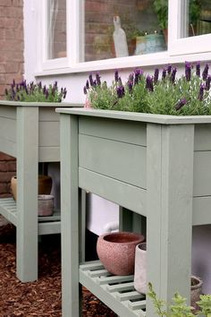 pair of sage green DIY raised planters - perfect for beginners, perfect for adding height and greenery to a patio or balcony and to create an easier way to grow herbs or flowers for those who have issues with mobility. #diy #diygarden #planter #diyplanter #diyraisedplanter #raisedstandingplanter #raisedbed #raisedbeddiy #uk Raised Planter Beds, Raised Beds, Country Charm, Diy Planters, Growing Herbs, Bold Colors, Greenery, Entryway Tables, Sage