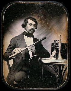 ca. 1845, [daguerreotype portrait of a mustachioed musician holding his flute] via Luminous Lint, from the private collection of W. & T. Bosshard, Courtesy of Carl Mautz Vintage Photography & Publishing