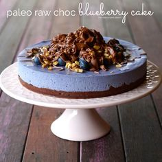 paleo choc blueberry cake 	 For the base 1 cup shredded coconut     1 cup raw walnuts     1/4 raw cacao powder     2 tbs. coconut oil     1 tbs. raw honey (or rice malt syrup)  For the filling     2 cups raw cashews (soaked overnight, if you don't it will still work, just won't be as smooth!)     1 cup coconut milk     1 cup blueberries (fresh or thawed frozen)     1/3 cup coconut oil     1 tbs. raw honey     1 tsp. 100% vanilla extract  For the toppings     1 cup fresh blueberries 3/4 cup…
