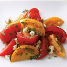 Summer-ripe tomatoes and fresh mozzarella need only a sprinkling of fresh herbs, salt and pepper to shine in this simple summer salad.