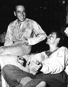 Humphrey Bogart and Errol Flynn. Flynn in costume for the movie Uncertain Glory.
