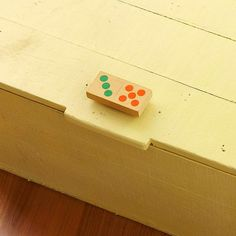 Add a little spunk to a trunk; this wood domino is a playful way to open a box or bin.
