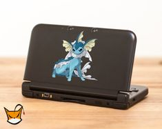 (*** http://BubbleCraze.org - You'll never put this Android/iPhone game down! ***)  Vaporeon Pokemon decal sticker for Nintendo 3DS XL by VinylGraf, $7.40