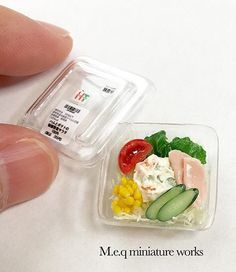 Too cute!! Miniature take out salad in plastic container.