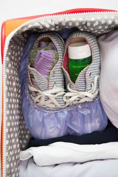 A shower cap protects clothes from dirt when you use it to cover the soles of your shoes in this clever packing hack.