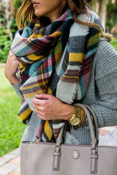Love this blanket scarf with a mustard + teal plaid. Unexpected!