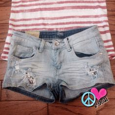 Light Wash Shorts with Flag Patches & Bling Machine ☮ Light Wash Shorts with Flag Patches & Bling ☮ Size 26'W X 2' Inseam ☮ ✌Super Stretch ( spandex ) So Comfy ✌️ Distress  Perfect A-1 Condition    ❌❌NO TRADE❌❌ Machine Shorts Jean Shorts
