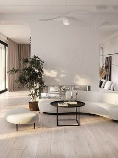 Curved sofa in a contemporary white living room - curvy furniture trend by the savvy heart -Modern interior design studio. Modern Minimalist Living Room, Living Room Modern, Interior Design Living Room, Living Room Designs, Living Room White, Minimalist Interior, White Living Room Furniture, Minimalist Room Design, Minimalist Sofa