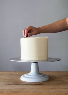 Let's get back to basics and down to business here. Smoothly iced and  structurally sound cakes are the building blocks of almost all decorative  cakes. I am happy to share my years of experience and show how to ice a  cake.  Using the following tips and tricks, you will be well on your to  creating a variety of designs. Today, I will be working with Swiss  Meringue Buttercream.The same techniques will apply when using fudge,  ganache, cream cheese, and any other meringue-based…