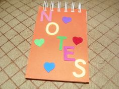 Great orange notebook to keep track of all your notes.