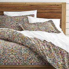 Shop Lucia Duvet Covers and Pillow Shams.  A traditional arabesque pattern scrolls contemporary in a colorful palette of plum, sage green, slate blue, pumpkin and gold on ivory.