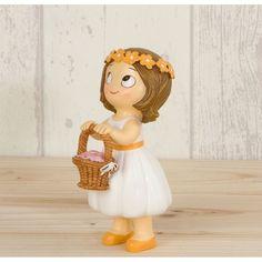 Completa las figuras de la tarta de boda con esta simpática niña que lleva una cesta con flores