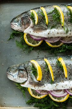 Stuffed with herbs, onion and lemon, then baked to flaky perfection on the Traeger, you won't want do your trout any other way. Whole Trout Recipes, Grilled Trout Recipes, Rainbow Trout Recipes, Fish Dishes, Seafood Dishes, Fish And Seafood, Seafood Recipes, Traeger Recipes, Grilling Recipes