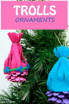 Trolls ornaments made from pine cones and inspired by Princess Poppy and Creek. Make these colorful ornaments for your Christmas tree. Adorable Trolls craft for kids. | at Non Toy Gifts