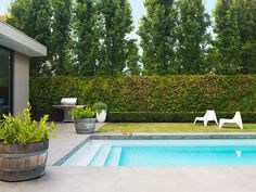 The homeowners designed this pool themselves as part of a whole-house renovation. Rather than tucking the pool into a corner of the property as is common practice, they installed it smack bang in the centre of the backyard. The 8x4m pool is tiled with white ceramic tiles, which imbues the water with a sky-blue colour. Poured concrete, scored to give the appearance of large-format pavers, takes the place of decking around the pool – an ultra low-maintenance option.