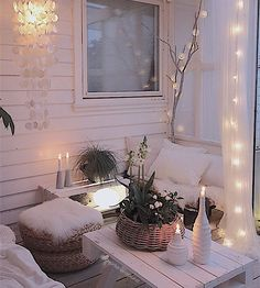 Balcony - Change all the pillow covers to white/grey add a stick in a planter with white lights, lots of green in baskets, lots of white and white lights, hang a shell/mirror wind chime