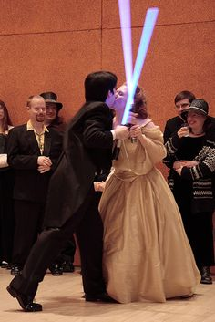Instead of a first dance... how about a first lightsaber battle!?
