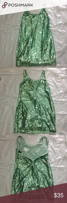 Green sequin dress Size L approx 34 inches long Green sequin dress from Rue 21.  Size L.  Zipper back.  Approx 34 inches long.  New tags attached. Rue 21 Dresses Mini