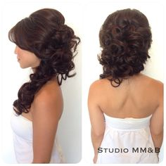 Hair by studio MM&B. Voluminous half up and half down hairdo to the side.