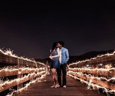 Sparks fly between the soon-to-be-wed couple in this stunning sparkler photograph.