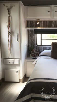 The Bedroom | After  #RVRenovation #RVRemodel #Glamper #VintageTrailerRemodel