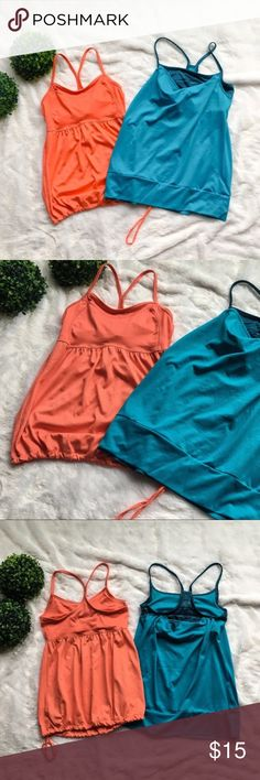 "Champion Workout Tank Bundle Set of two Champion workout tank tops. Selling as a set only. Both are a size extra small and purchased from Target. No flaws to either of them. The teal one is roughly 24"" long and the orange one is roughly 23"" long. I'm only looking to sell at this time so sorry but no trades. My listing price is firm. Champion Tops Tank Tops"