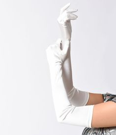 Add a dramatic flair to your next formal outfit by accessorizing with these ivory satin 23-inch opera gloves from Unique Vintage. Although theyre much too theatrical for daily wear, these vintage-inspired gloves extend above the elbows to create the perf