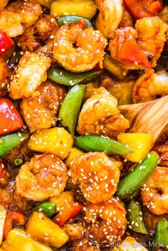 PIN TO SAVE FOR LATER! Pineapple shrimp stir fry is a sweet, delicious, and healthy dinner recipe that's always a hit. An easy to make stir fry sauce coats the tender shrimp, sweet pineapple chunks, and our favorite veggies. It's quick to make and so much better than takeout! #theendlessmeal #shrimpstirfry #pineapple #shrimp #prawns #pineapplestirfry #stirfry #pineappleshrimpstirfry #refinedsugarfree #takeout #takeoutrecipes #chinesetakeout #stirfryrecipes #healthyrecipes #shrimprecipes