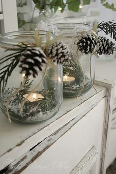 Re-use old jars by adding some greenery, a tea light candle and Epsom or rock salt. Finish with some string and small pine cones. A great table decoration.