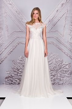 fba93244b2e Suzanne Neville is a British designer who has become one of Europe s  leading Bridal designers.