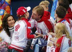 Yulia Lipnitskaya of Russia is greeted by Evgeny Plyushchenko during the Team Ladies Free Skating Program at the Sochi 2014 Winter Olympics