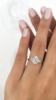 Oval shaped center stone with two baby heart shaped diamonds on each side Oval Engagement, Dream Engagement Rings, Princess Cut Engagement Rings, Three Stone Engagement Rings, Designer Engagement Rings, Ring Verlobung, Couple Gifts, Couple Things, Heart Shaped Diamond