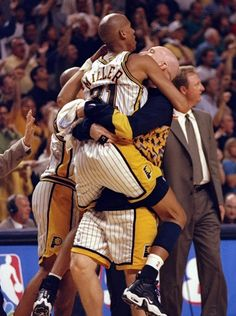 May 23, 1998: Reggie Miller #31 of the Indianapolis Pacers hugs Chris Mullin #17 during the NBA Eastern Conference Finals at the Market Square Arena in Indianapolis, Indiana. The Pacers defeated the Bulls 107-105.
