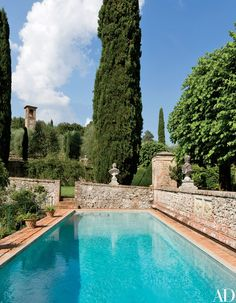 Stone walls surround the swimming pool | archdigest.com