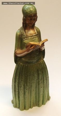 Lot 396 - 1930's plaster Figurine of a lady reading in green dress with curly Hair - marked BB to base