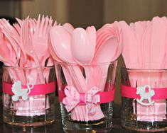 Simple way to decorate utensil holders at a baby shower. Simply use a small drink glass and hot glue ribbon around it. Then top with a baby bow or trinket.